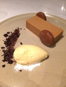 Caramelized white chocolate terrine with cocoa and caraway macaroons, ginger ice cream, white chocolate snow