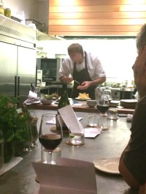 Josh Lewis plating up the smoked mullet dish
