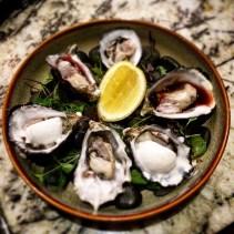 Smoky Bay oysters - natural, lemon sorbet and vinaigrette