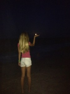 """My niece Evie """"holding the moon..."""" (Photo by Jenny Flaugh, 2012.)"""