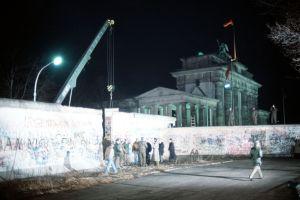 Crane taking down the Berlin Wall near 1990. (Public photo)