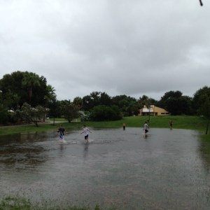 Kids play in the retention pond in Sewall's Point. (Photo Simone McPhee)