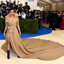Priyanka Chopra is a total badass in this most recent update of the trench coat that is begging for a place in the next Bond movie.
