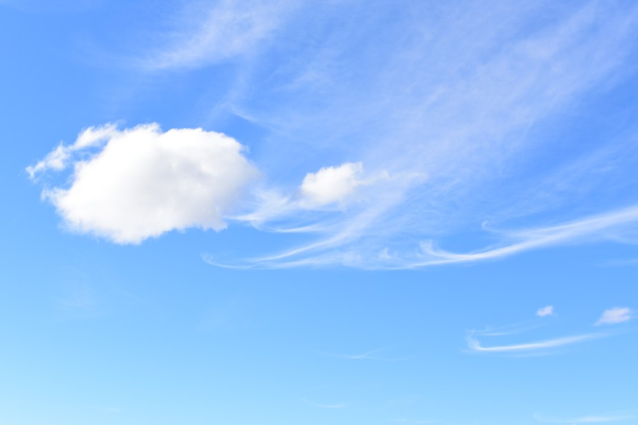 Cumulous clouds next to cirrus clouds. Image by Jade Jackson.