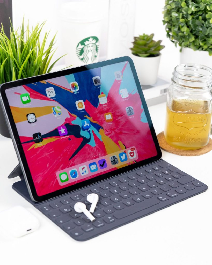 iPad Pro. Magnetic Keyboard. AirPods. Plants. Reusable Starbucks Travel Cup