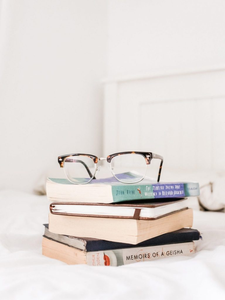 5 Things I Wish People Understood About Autism • stacked books and glasses
