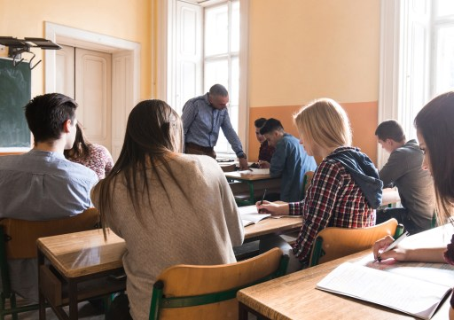 Large group of high school students during a class in the classroom.