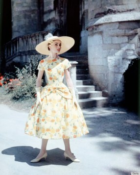 Belgian-born actress Audrey Hepburn (1929 - 1993) in a floral-print day dress and sun hat, circa 1955. (Photo by Silver Screen Collection/Getty Images)