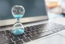 Hourglass on laptop