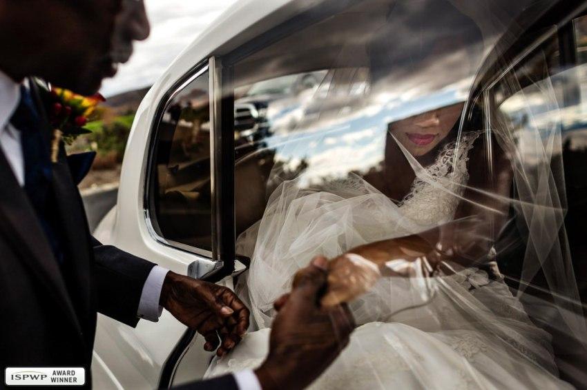 bride through reflection of car window
