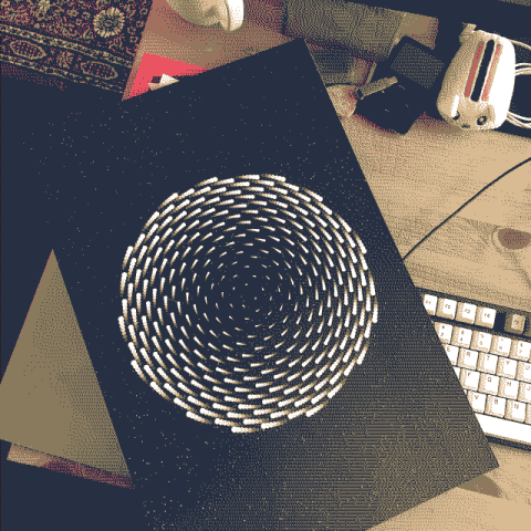 A print of my art of a spiral on top of my keyboard.
