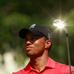 The sun reflects off the club as Tiger Woods hits off on the seventh tee at the AT&T National golf tournament in Bethesda, Maryland