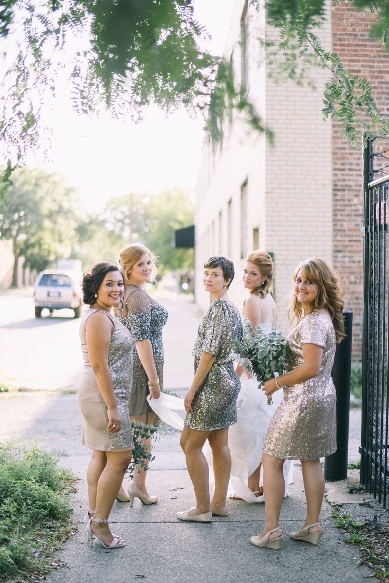 bridesmaids in gold glitter dresses and eucalyptus bouquet