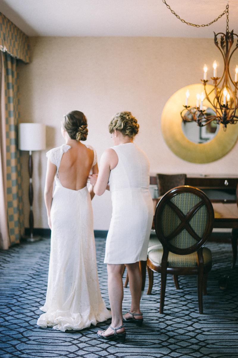 Mom helping bride get dressed for St Paul wedding