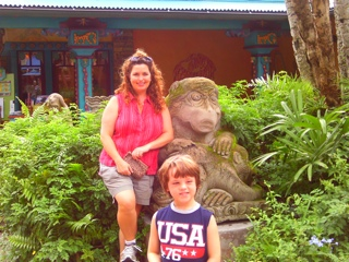 picture of monkey statue at Disney Animal Kingdom with Jaime and her son