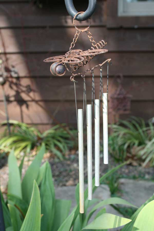 rusted dragonfly wind chimes