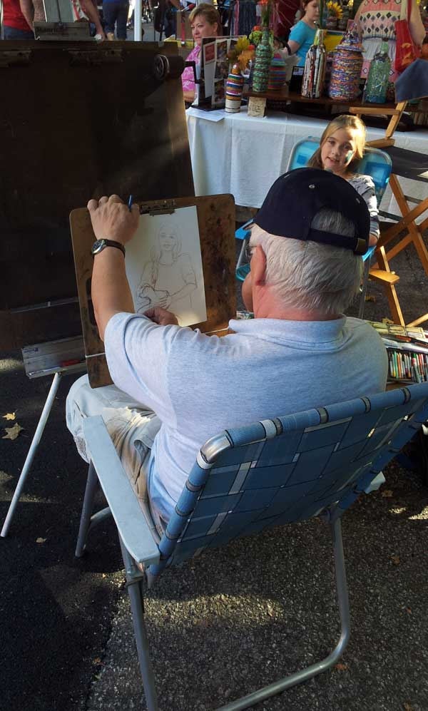 artist sketching a young girl
