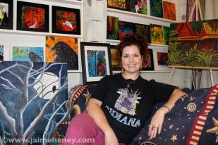 Jaime sitting in her studio