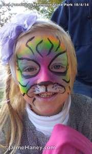 Happy Rainbow Tiger face paint
