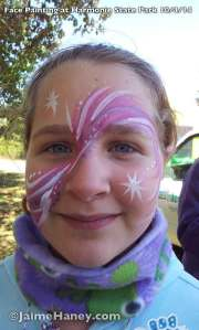 Frosty pinks, purples and white swishes face painting