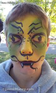 snake or lizard painted face