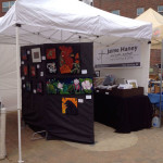 outside art show booth with tent