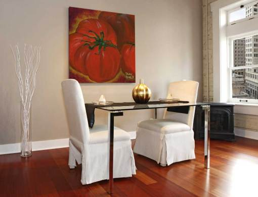 Red tomatoes artwork shown in a modern dining room