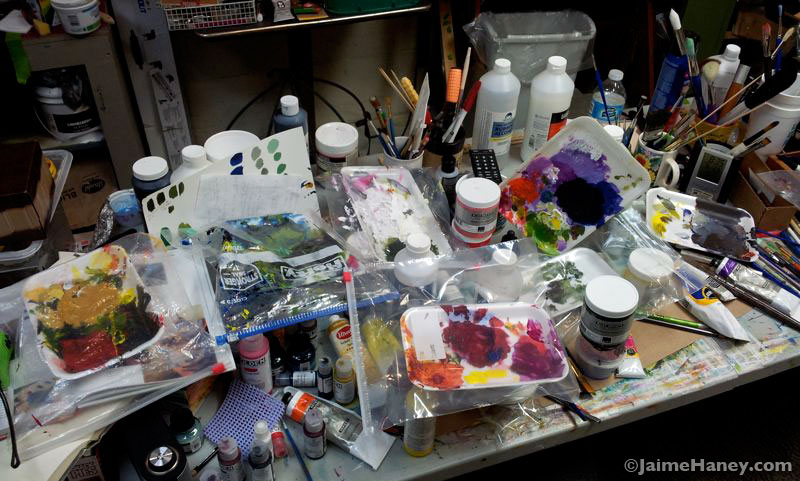 My messy art studio work table after an art show
