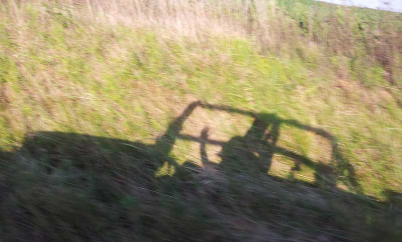 Jeep shadow in field
