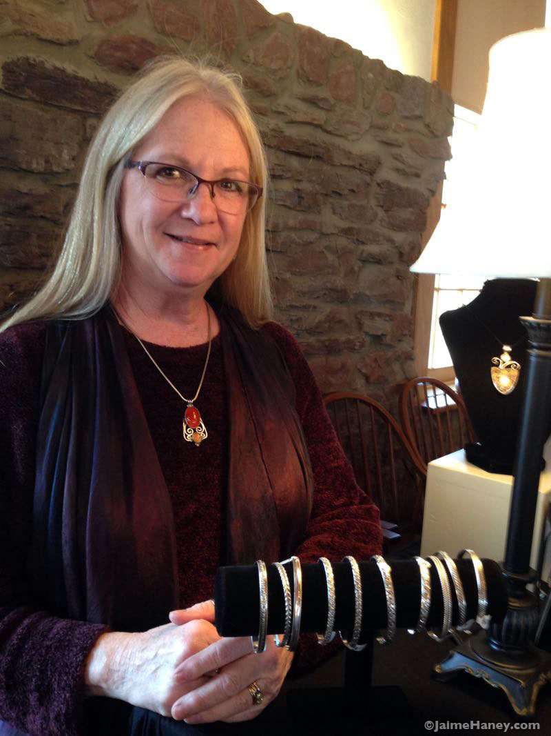 Sue Rappee with her jewelry at the Granary in Christmas in New Harmony