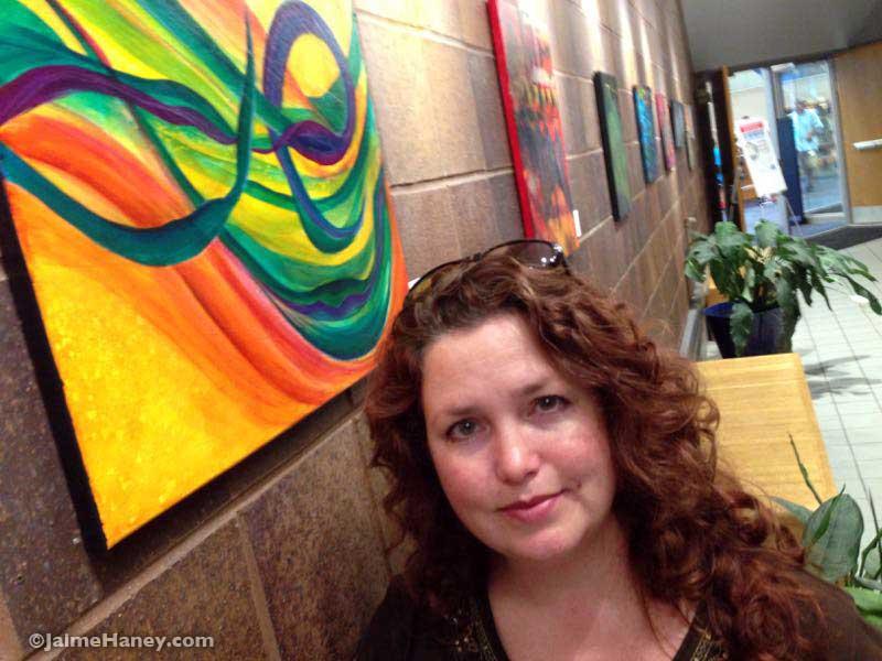 Jaime Haney with her art exhibit