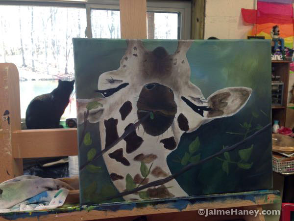 JuJu in the window in my art studio and a giraffe painting on my easel