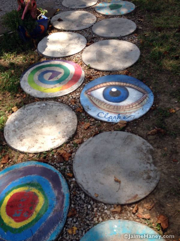 painted stepping stones in staC Gallery backyard