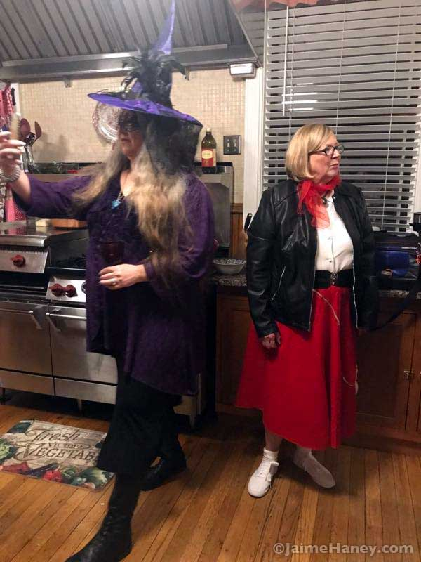 Purple witch and 50's girl costumes