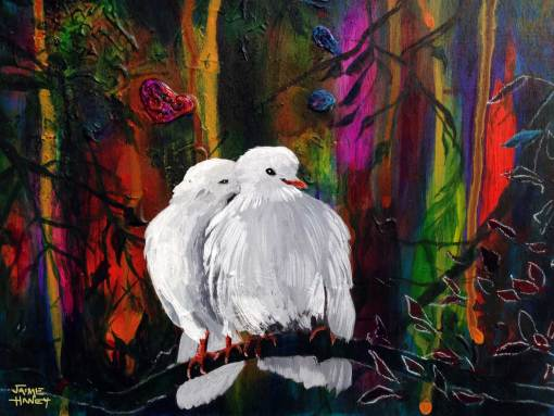 Two white doves nuzzling together