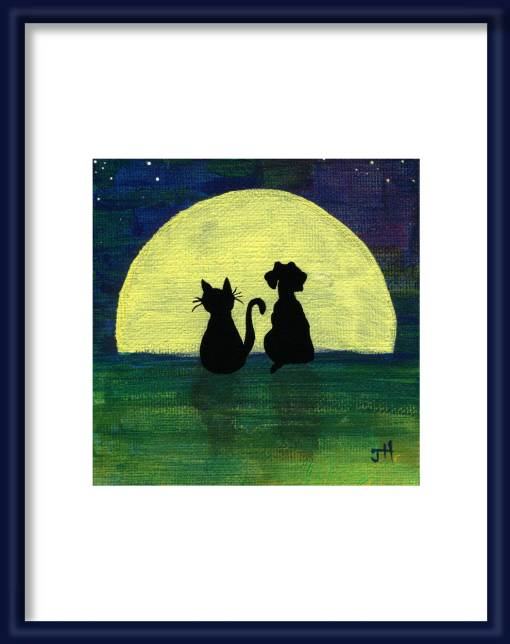 Cat and dog looking at the full moon art print shown in a frame