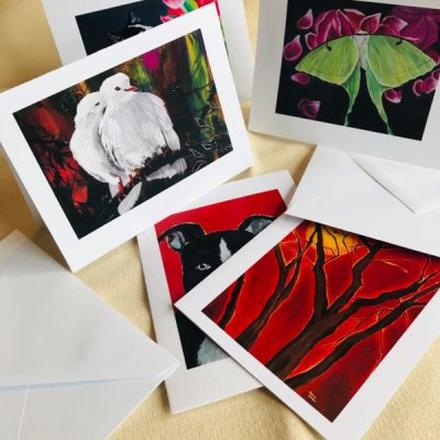 Single note cards with paintings by Jaime Haney on them with white envelopes.
