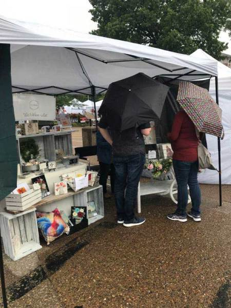 art show booth in the rain