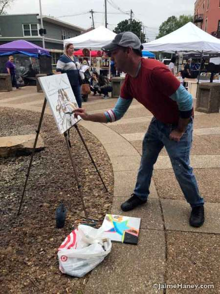 Vincent Boren painting the fountain at Haynie's Corner.