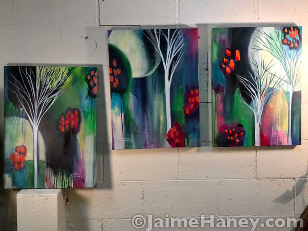 finished moon and tree paintings
