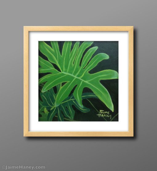 painting of a philodendron shown matted and framed on gray wall.