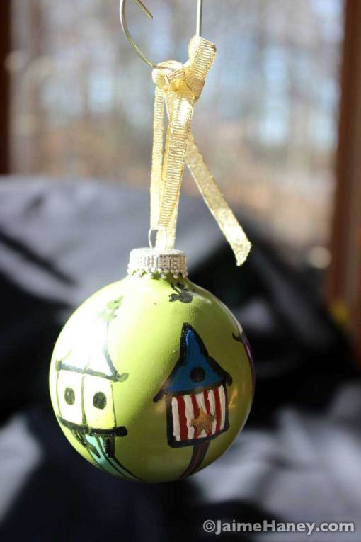 Bird houses ornament shown hanging