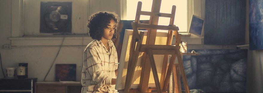 girl at painting easel