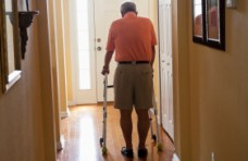 Senior man with walker at home