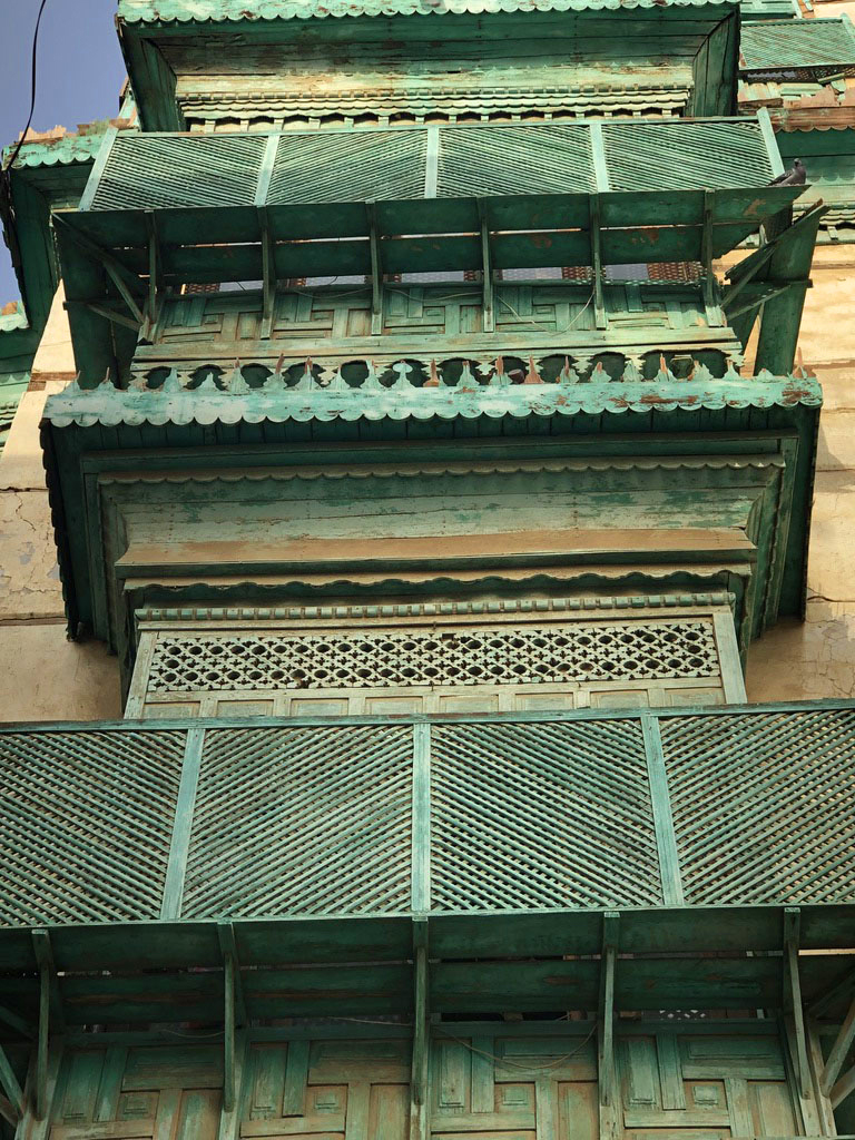 Green turquoise mashrabiyah wood latticework in Jeddah Al Balad in Saudi Arabia