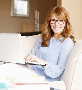Woman sitting with her laptop