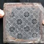 A piece of original sand blown window