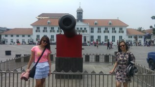 Mae and Mona in front of the legendary and iconic canon and the oldest building in the area.