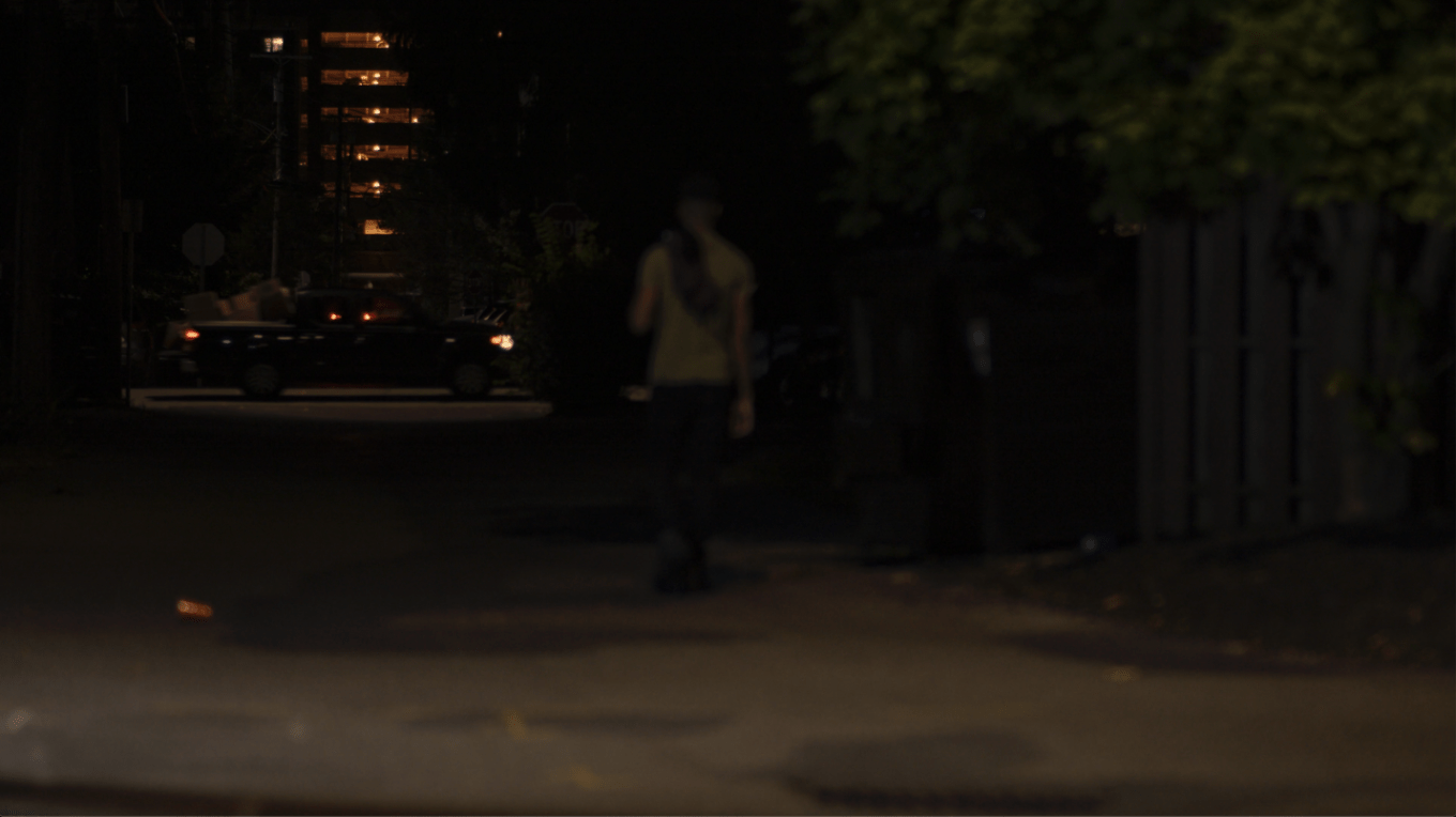 A person walking in the dark  Description automatically generated with low confidence
