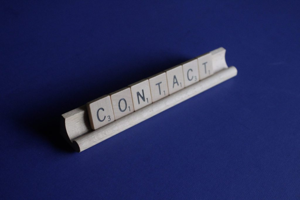 Contact spelled out in Scrabble tiles on a rack. I love Scrabble. Photo by Melinda Gimpel on Unsplash
